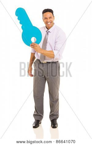 cheerful middle aged man showing blue paper key