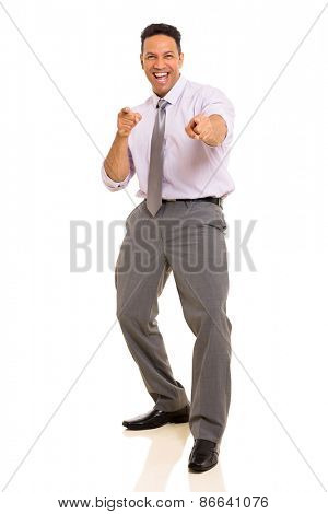 joyful middle aged man pointing at the camera isolated on white background