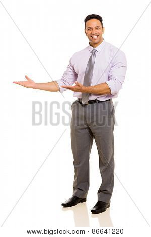 successful middle aged businessman doing welcome gesture on white background
