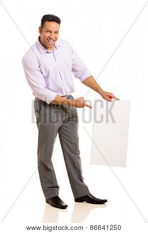 happy mid age businessman pointing at blank white board over white background