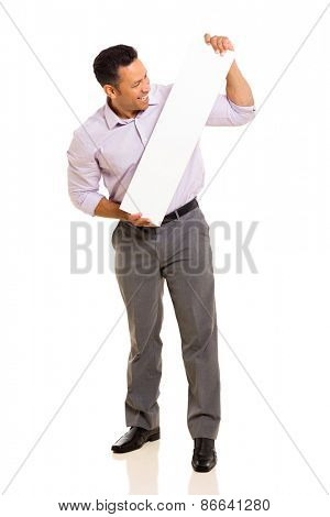 middle aged man looking at blank white board on white background
