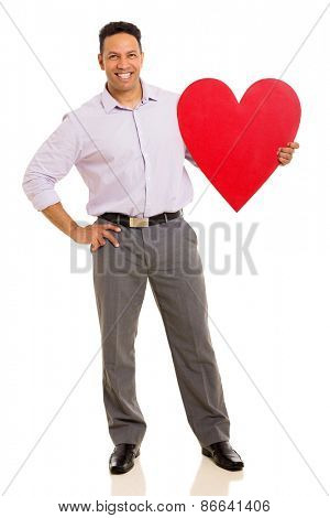 handsome middle aged businessman holding red heart symbol on white background