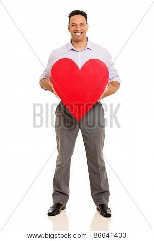 happy middle aged man holding red heart against white background