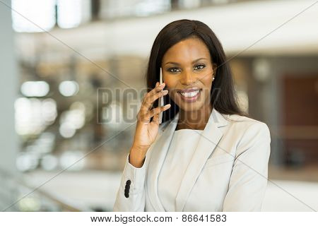 pretty african business woman making a phone call