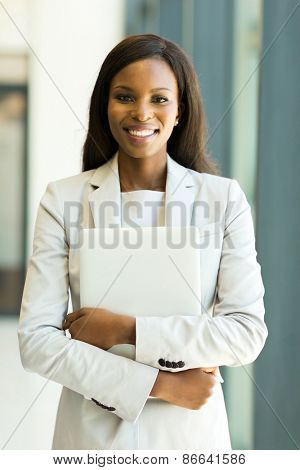 attractive afro american office worker holding laptop computer