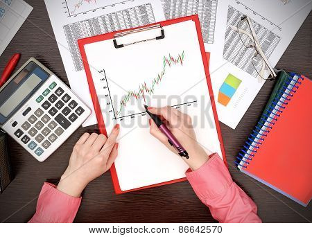 Woman Drawing Stock Chart