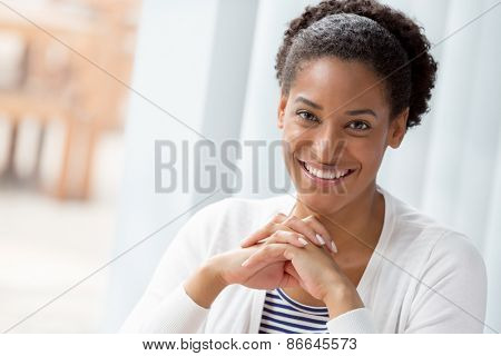 Businesswoman smiling and looking at camera