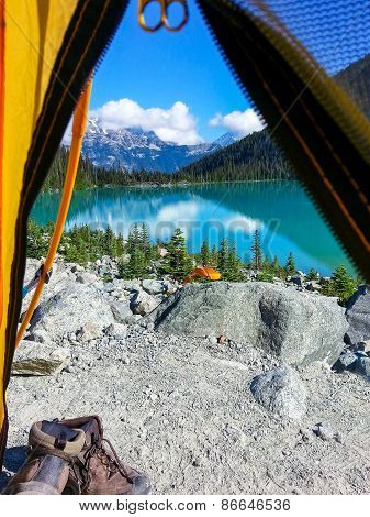 Camping tent with a view of a lake