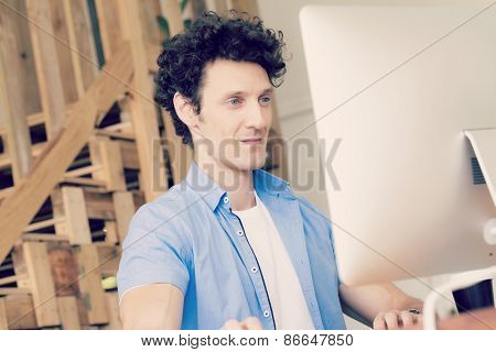 Man in casual wear working in office