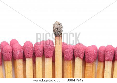 Row of matches with one standing out