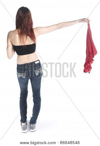 Rear View of a Woman Holding her Shirt on the Side