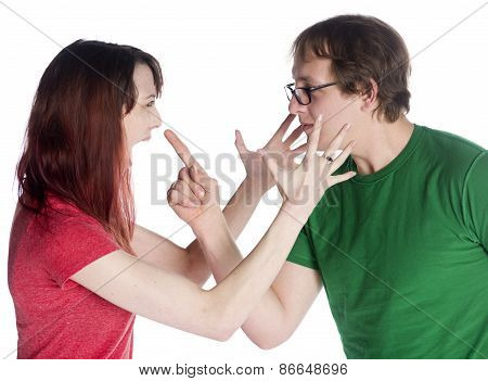 Close up Angry Young Couple Facing Each Other