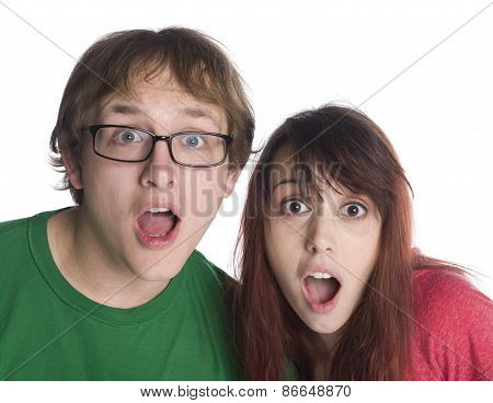 Shocked Couple with Mouth Open Looking at Camera