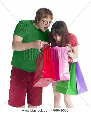 Couple Looking Into Paper Bag in Amaze Expression