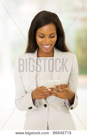 beautiful young afro american career woman using cell phone