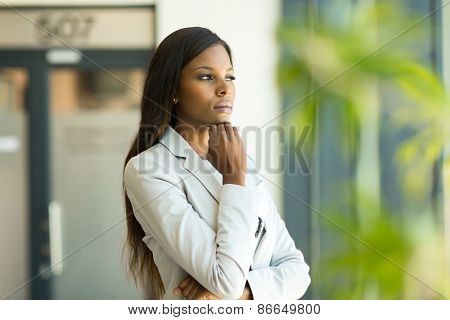 thoughtful afro american business executive in modern office