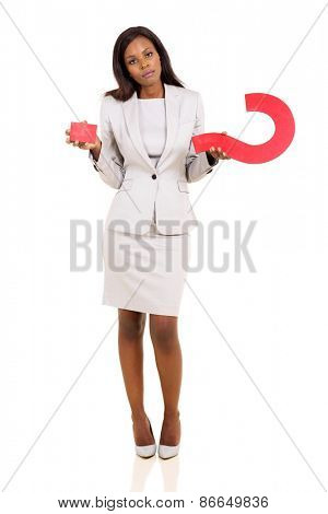 confused african american woman holding question mark on white background