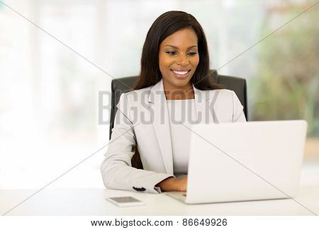 happy afro american businesswoman using computer in office