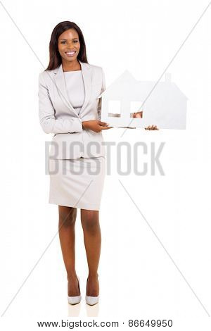 young african american woman holding paper house isolated on white