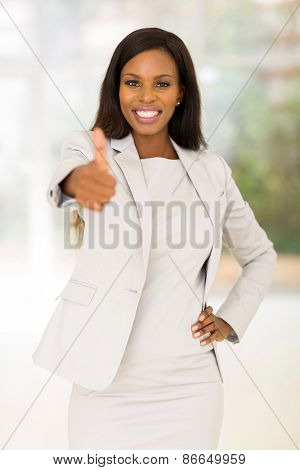happy african business woman giving thumb up in office