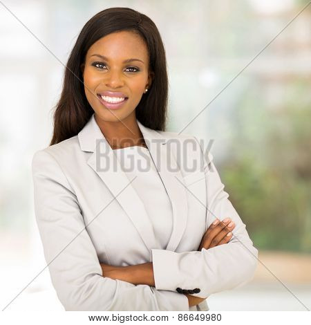 gorgeous african business woman with arms folded in modern office