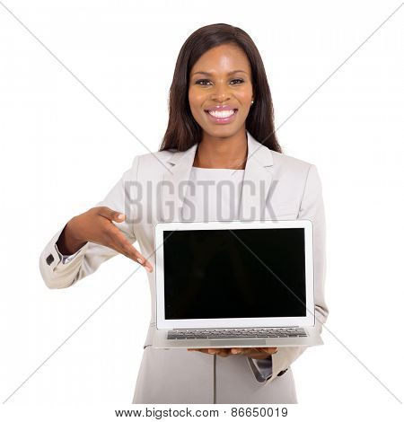 happy african businesswoman presenting black laptop screen on white background
