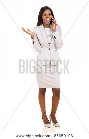 cheerful african business executive making a phone call isolated on white