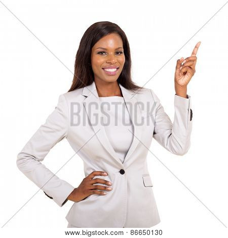 beautiful young african businesswoman pointing up