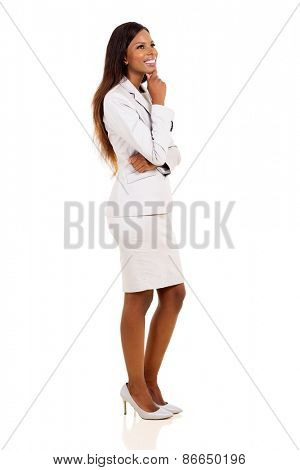 thoughtful young african businesswoman looking up isolated on white