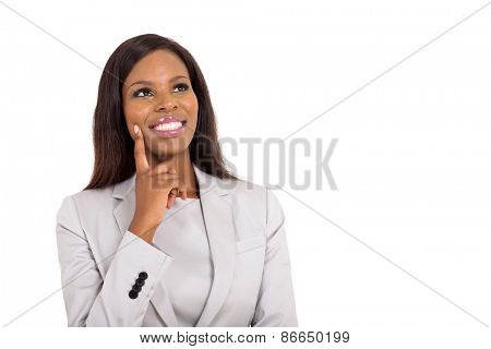cheerful african businesswoman looking up on white background