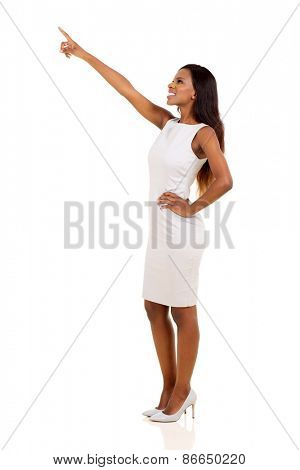 pretty african american businesswoman pointing empty space isolated on white background