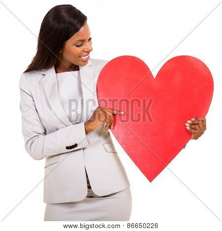 african woman showing red heart symbol isolated on white
