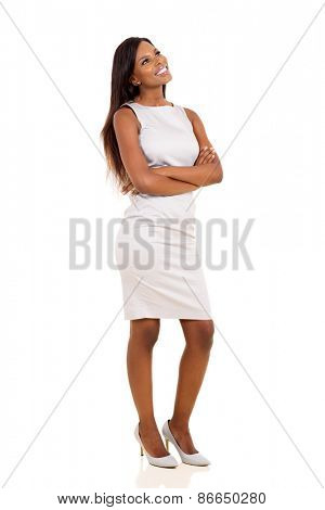 beautiful african woman with arms crossed standing on white background