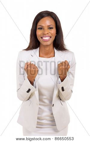 excited african american businesswoman waving fists isolated on white background