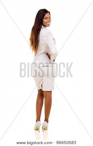 happy african woman looking back on white background