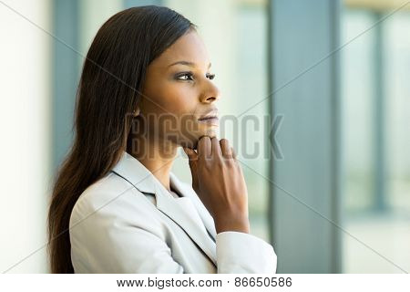 thoughtful african businesswoman in modern office