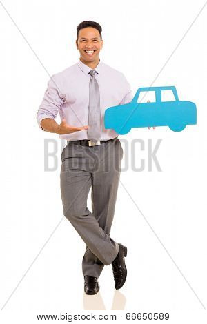 cheerful mid age man presenting paper car isolated on white background