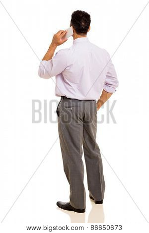 rear view of man talking on cell phone isolated on white background