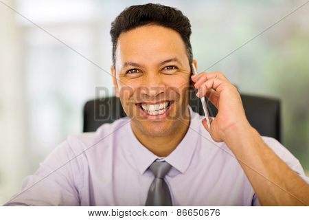 good looking businessman talking on smart phone