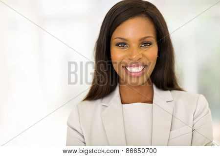 cheerful young businesswoman in modern office