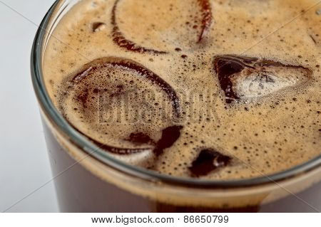 Iced espresso coffee in glass on a white