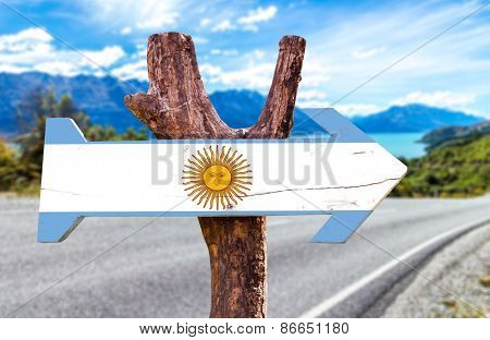 Argentina wooden sign with a road background