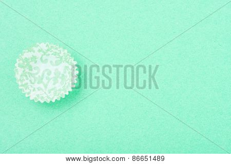 Empty Patterned Cupcake Liner On Textured Background