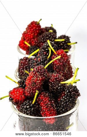 Fresh Organic Mulberry In Glasses On White Background.