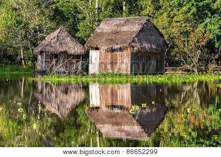 Shacks Reflected In The Amazon