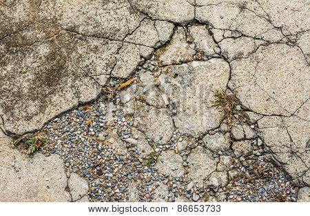 Image Of Small Pebble Rock On Cracked Cement Ground