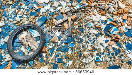 An Old Tyre In A Broken Glass Zone