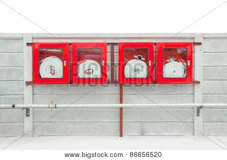 Emergency Fire Hose Inside A Glass Fronted Box Mounted On A Wall.