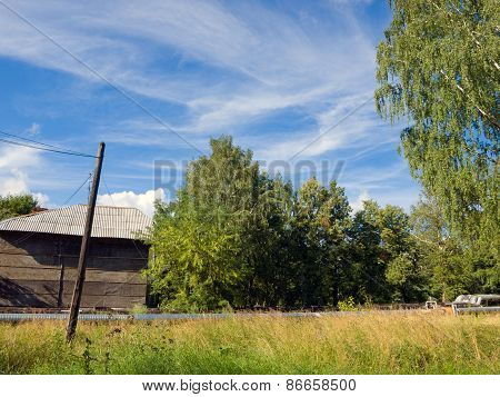 Old wooden house in the village against a beautiful blue sky