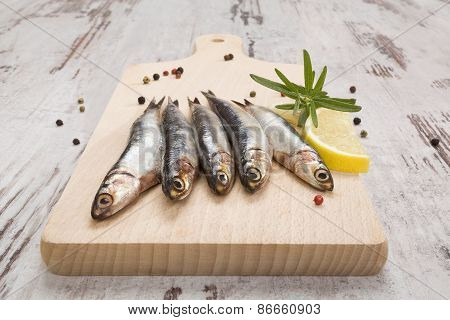 Sardines On Wooden Kitchen Board.